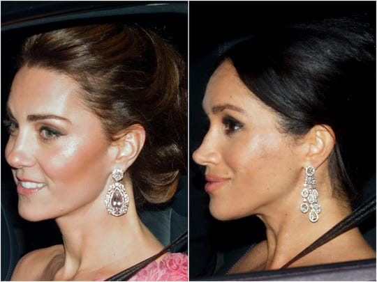 Duchess Kate and Duchess Meghan were snapped driving out of Kensington Palace en route to the party at the big house.