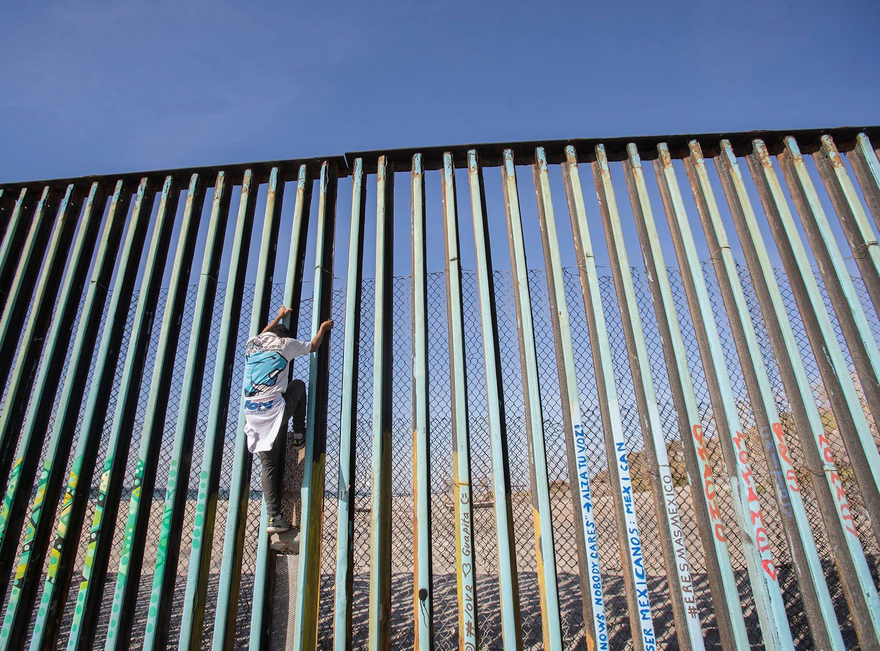 Members of the fist wave of the migrant caravan visit Playas De Tijuana after arriving in Tijuana, Mexico on Nov. 13, 2018.