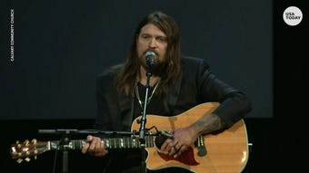 Billy Ray Cyrus paid tribute to Ventura County Sheriff Sergeant Ron Helus at the memorial service for the fallen officer. Helus was killed while responding to the Thousand Oaks shooting.
