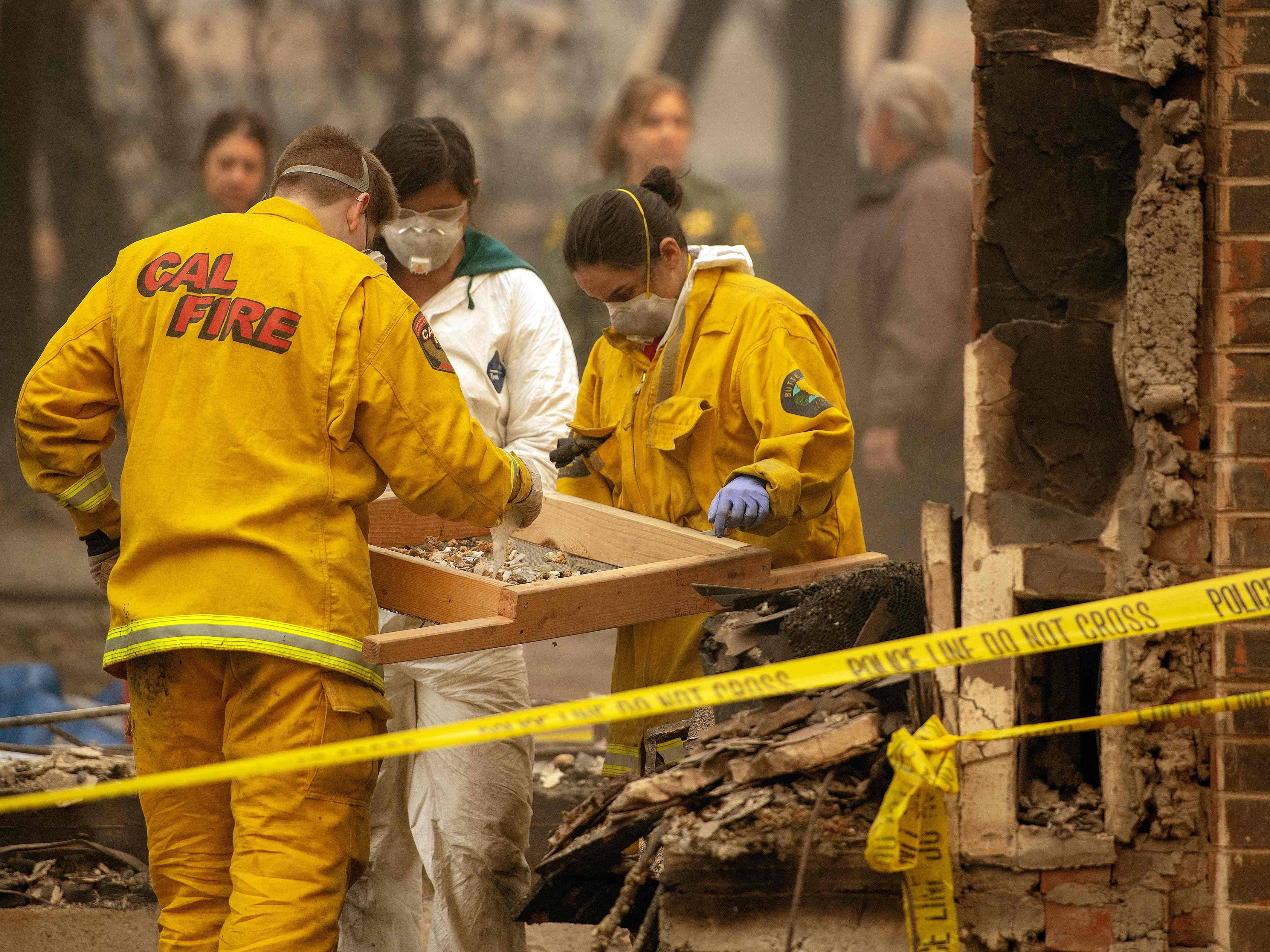 Rescue workers sift through rubble in search of human remains at a burned property in Paradise, Calif. on Nov. 14, 2018.