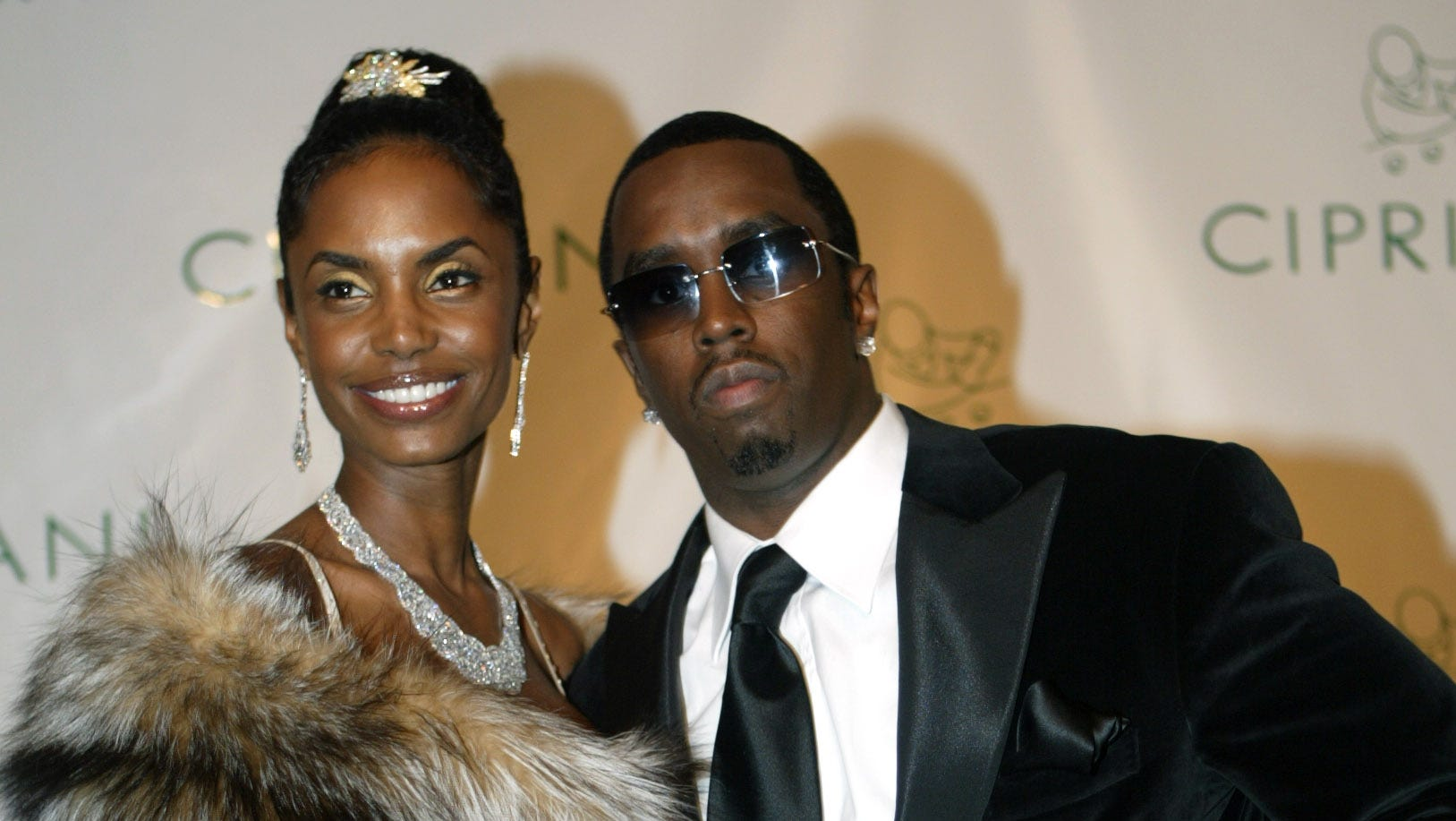 """Kim Porter has reportedly died. Here, Sean """"Diddy"""" Combs and Kim Porter, left, pose on Nov. 4, 2004, as they arrived for Combs' 35th birthday celebration in New York."""