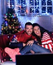 Couple enjoys TV program during the holidays