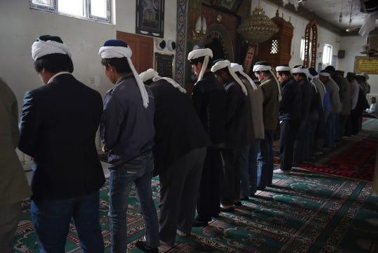 Uighur men praying in a mosque in Hotan, in China's western Xinjiang region, in 2015.