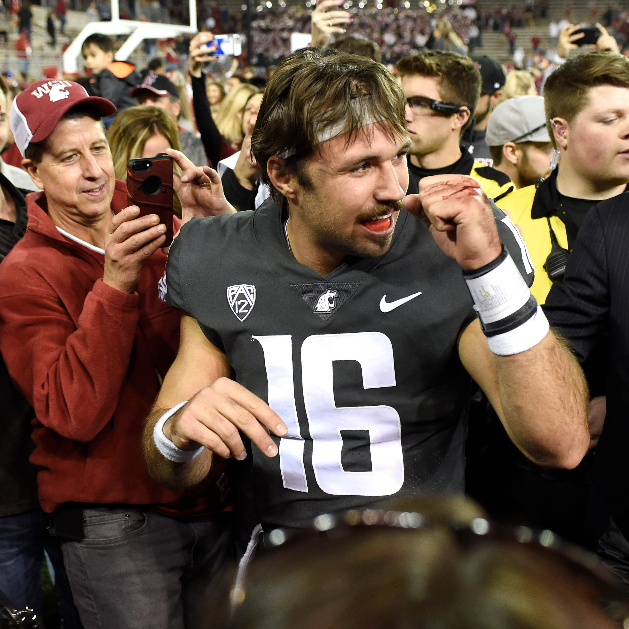 Washington State quarterback Gardner Minshew celebrates after the Cougars defeated Oregon.