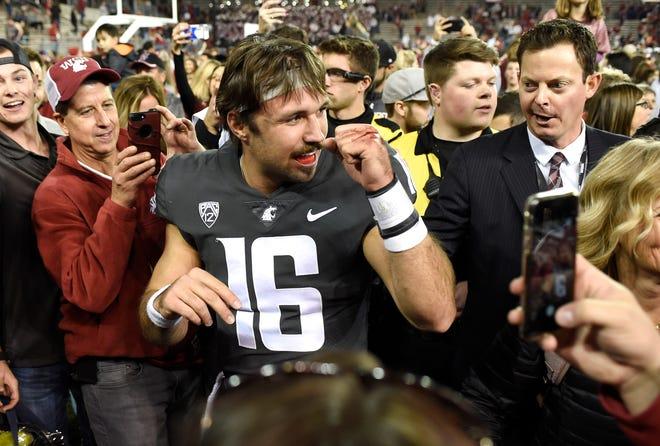 Washington State quarterback Gardner Minshew celebrates after the Cougars defeated Oregon.
