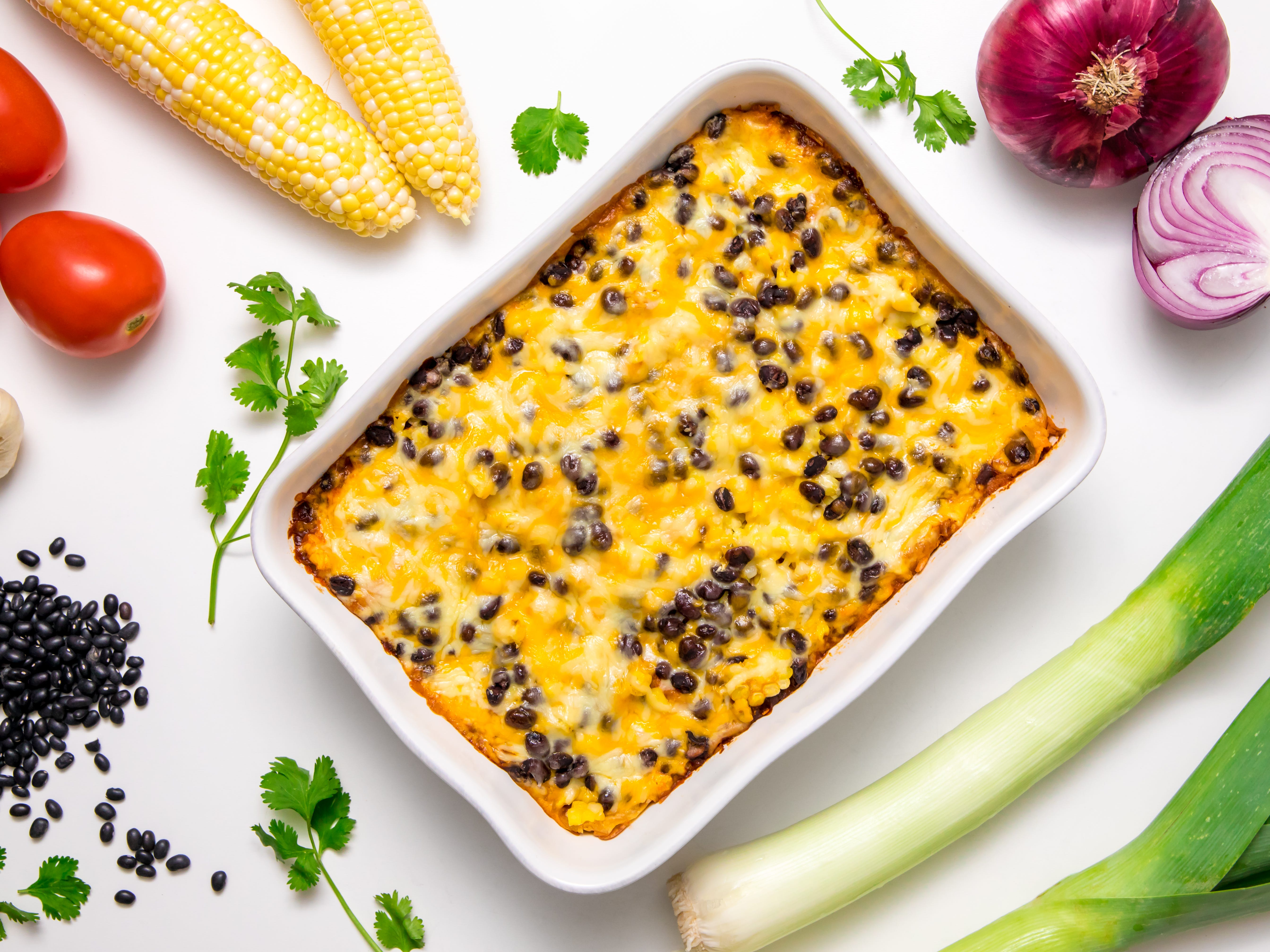 This loaded turkey enchiladas recipe is one of the tastiest of options! When we say loaded, we mean generously stuffed turkey and cheese enchiladas snuggly arranged in a casserole dish, then lavishly scattered with a scrumptious combination of corn, black beans, and more cheese. When these leftover turkey enchiladas come out of the oven, your family is going to race to the table and fight for the first indulgent bite.