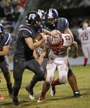 Rosepine running back Seth Shirley (36) powers his way for yards against DeQuincy in Week 9.