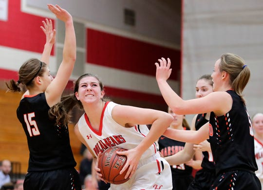 Hortonville's Macy McGlone works her way to the basket during a game against Marshfield on Nov. 15 in Hortonville.