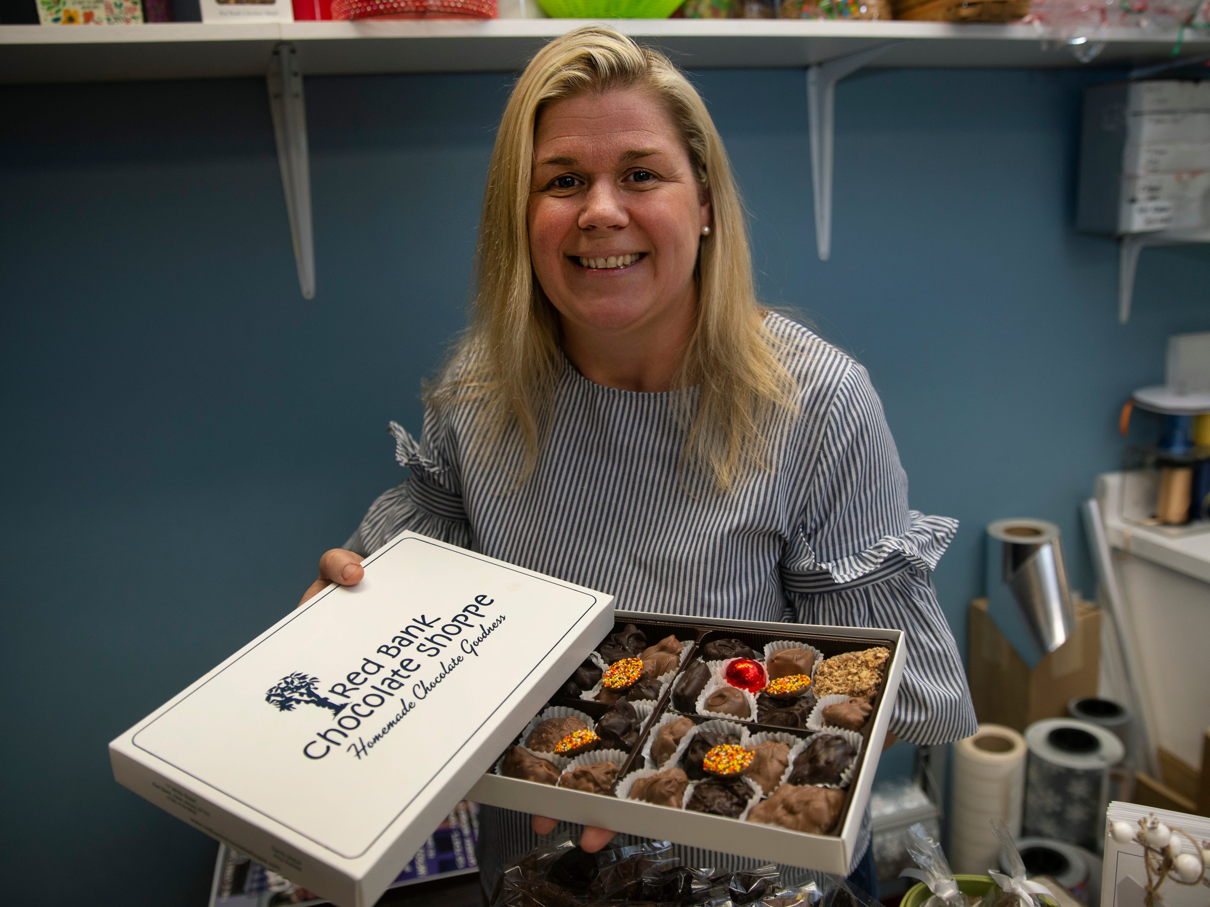 Amy Berry Healy with one of the boxes of assorted chocolates she sells at the Red Bank Chocolate Shoppe.