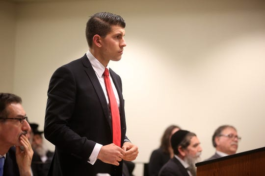 Anthony Robinson, deputy attorney general, answers questions as Rabbi Osher Eisemann, founder of Lakewood's School for Children with Hidden Intelligence and who is facing criminal charges alleging misuse of public money, appears before Judge Benjamin Bucca at the Middlesex County Courthouse in New Brunswick, NJ Friday, November 16, 2018.  His lawyer, Lee Vartan, is arguing the indictment should be dismissed because an amount equal to the taxpayer dollars allotted to the school was spent on legitimate purchases.