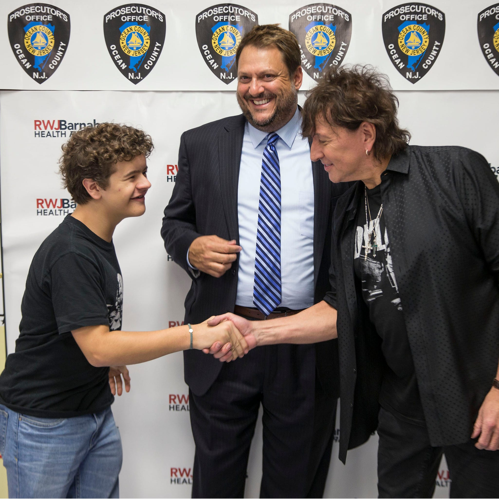 Actor Gaten Matarazzo and Prosecutor Brad Billhimer with Richie Sambora. The Ocean County Prosecutor's Office presents Unbreakable, A Forum Against Bullying to bring attention to a problem experienced by many children. The show performed at RWJ Barnabas Health Arena included musician Richie Sambora, baseball player Todd Frazier, and actor Gaten Matarazzo among others.Toms River, NJThursday, November, 15, 2018