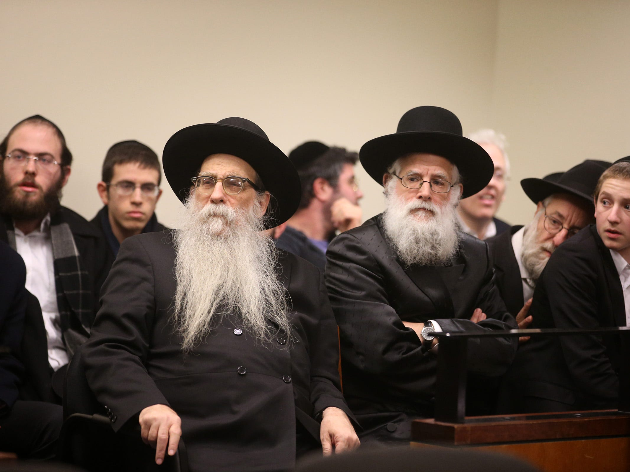 Rabbi Yeruchem Olshin, the dean of BMG, sits in the courtroom gallery as Rabbi Osher Eisemann, founder of Lakewood's School for Children with Hidden Intelligence and who is facing criminal charges alleging misuse of public money, appears before Judge Benjamin Bucca at the Middlesex County Courthouse in New Brunswick, NJ Friday, November 16, 2018.  His lawyer, Lee Vartan, is arguing the indictment should be dismissed because an amount equal to the taxpayer dollars allotted to the school was spent on legitimate purchases.