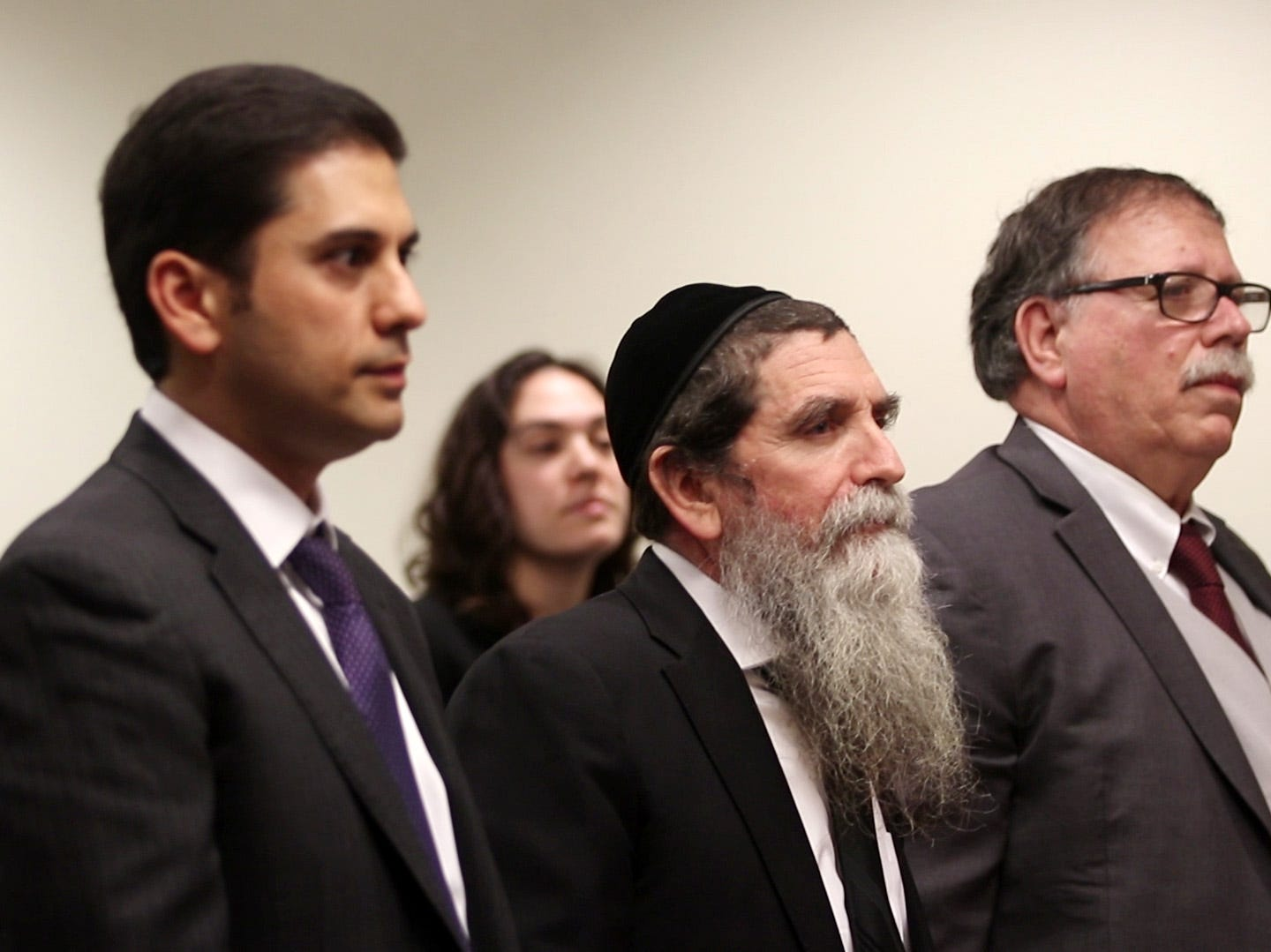 Rabbi Osher Eisemann, founder of Lakewood's School for Children with Hidden Intelligence and who is facing criminal charges alleging misuse of public money, appears before Judge Benjamin Bucca at the Middlesex County Courthouse in New Brunswick, NJ Friday, November 16, 2018.  His lawyer, Lee Vartan, is arguing the indictment should be dismissed because an amount equal to the taxpayer dollars allotted to the school was spent on legitimate purchases.