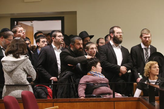 A large crowd of supporters fill the courtroom as Rabbi Osher Eisemann, founder of Lakewood's School for Children with Hidden Intelligence and who is facing criminal charges alleging misuse of public money, appears before Judge Benjamin Bucca at the Middlesex County Courthouse in New Brunswick, NJ Friday, November 16, 2018.  His lawyer, Lee Vartan, is arguing the indictment should be dismissed because an amount equal to the taxpayer dollars allotted to the school was spent on legitimate purchases.