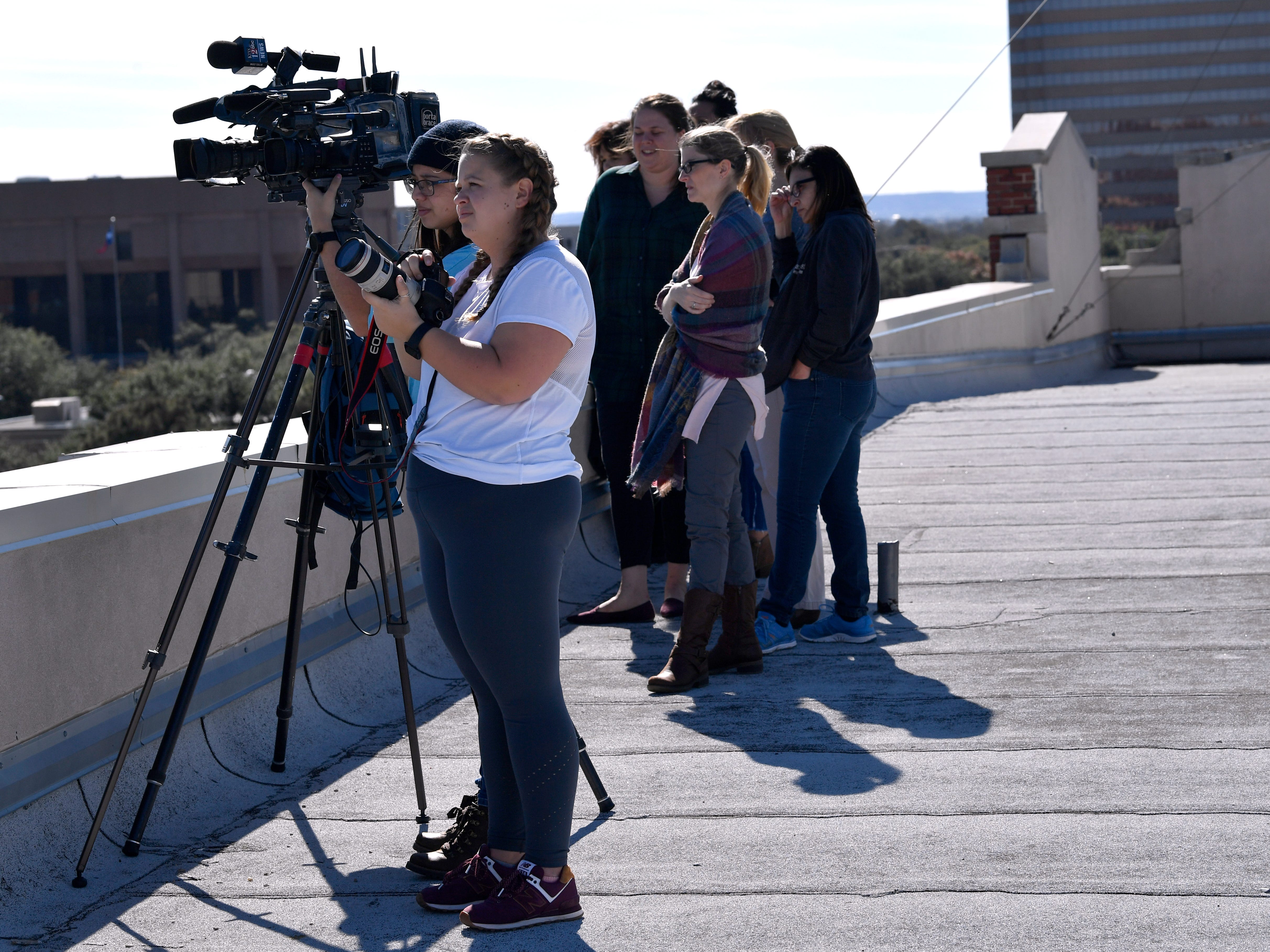 Abilene media and others watch from the roof of the Grace Museum as firefighters battle a two-alarm fire at the Abilene Reporter-News Thursday Nov. 15, 2018. The fire was called in at 9:20 a.m., the building was evacuated and no injuries were reported.