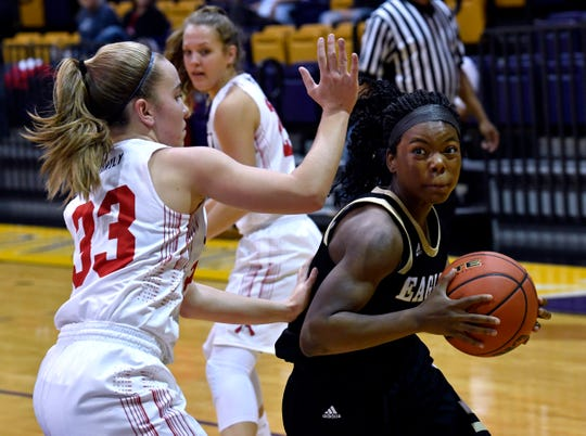 Jim Ned's Brooke Galvin guards Abilene High's Trakenya Roberson during Friday's Polk - Key City Basketball Classic at Hardin-Simmons University.