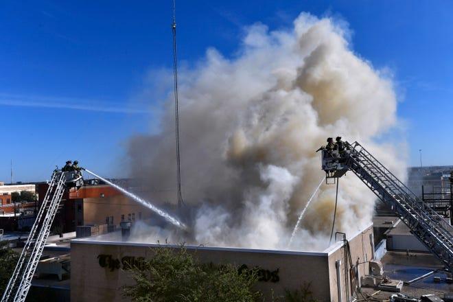 Abilene firefighters respond to a two-alarm blaze at the Abilene Reporter-News Thursday.