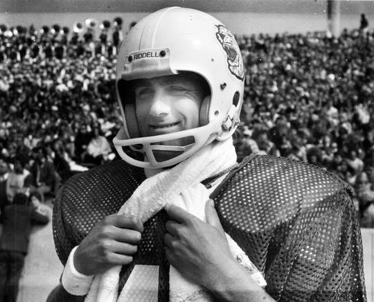 ACU kicker Ove Johannson smiles during a game.