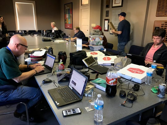 Abilene Reporter-News employees set up a temporary work space at The Grace Museum after a two-alarm fire forced the evacuation of the newspaper's building on Thursday, Nov. 15, 2018.