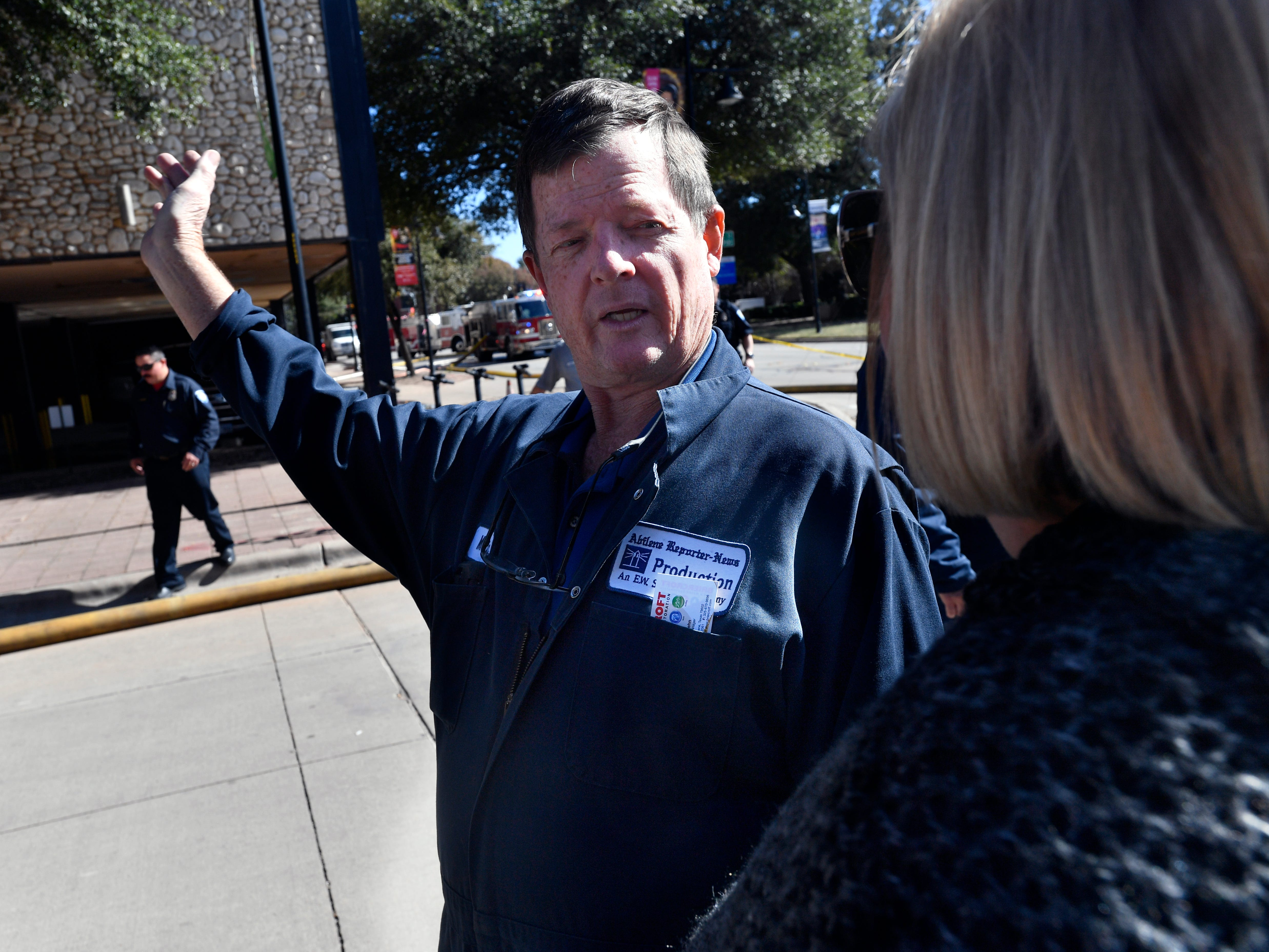 Martin Thomas, director of operations, speaks with Missy Keefer, regional sales director for central Texas Gannett, in front of the Abilene Reporter-News Thursday Nov. 15, 2018. Abilene firefighters responded to a two-alarm blaze at the Abilene Reporter-News Thursday. The fire was called in at 9:20 a.m., at one time all three of the city's ladder trucks were employed during the fight.,