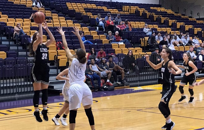 Bishop Lynch's Addison Knott shoots over Coopers Alexis Garcia during the Friars 88-33 win over Cooper Friday morning in the second round of the Polk-Key City tournament.