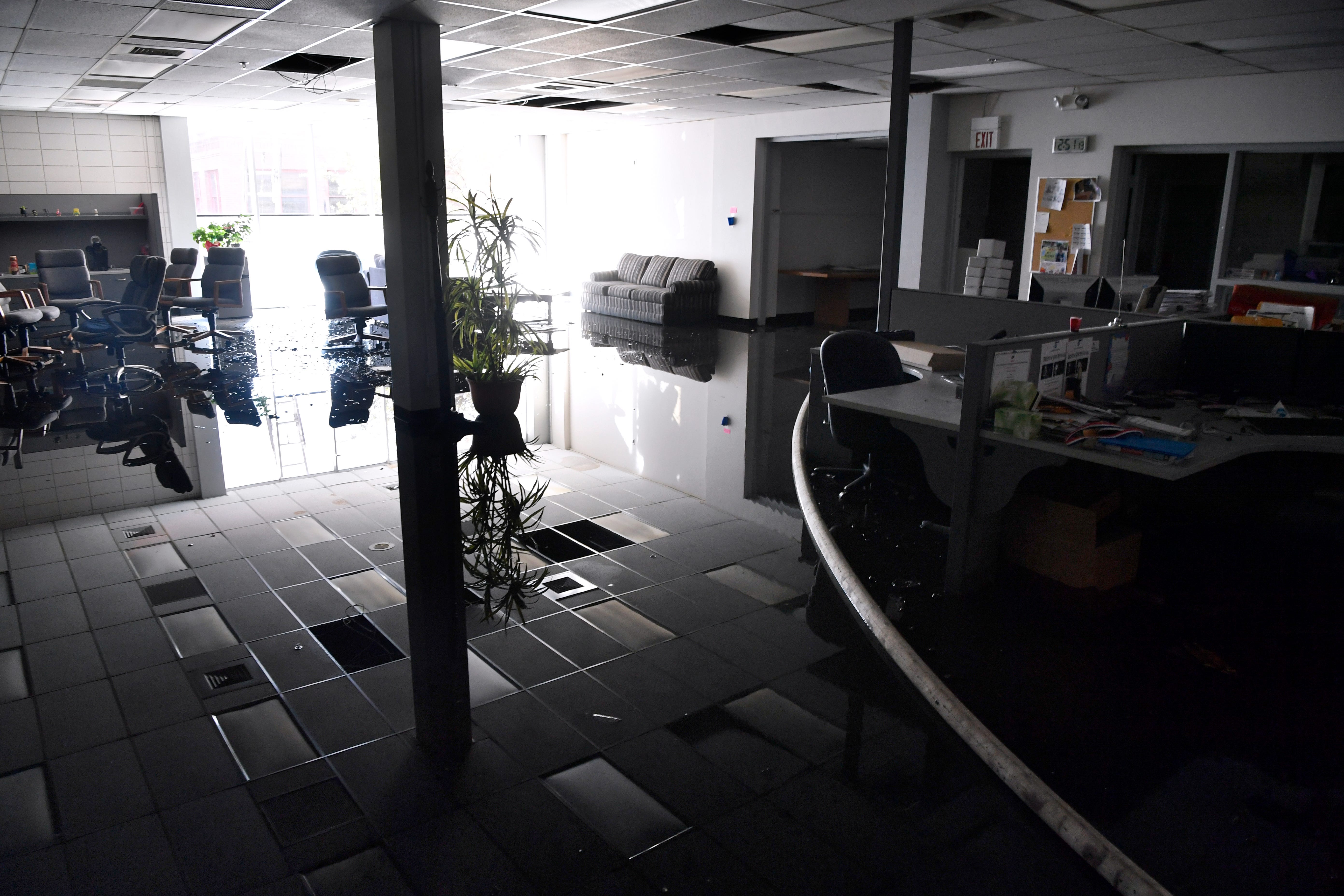 Two to three inches of water covers the newsroom of the Abilene Reporter-News Thursday Nov. 15, 2018. Abilene firefighters respond to a two-alarm blaze at the newspaper at 9:20 a.m., by 2:30 firefighters were escorting some employees in to retrieve hard drives and other items.