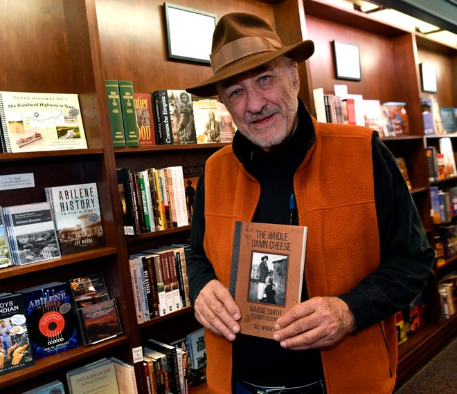 """Bill Wright holds a copy of his latest book, """"The Whole Damn Cheese"""", at Texas Star Trading Company Nov. 13, 2018."""