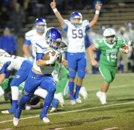 Brock's Toby Morrison runs 28 yards for the game's first touchdown. against Breckenridge. The score gave the Eagles a 6-0 lead over Breckenridge with 3:41 left in the first quarter of the Region I-3A Division I bi-district playoff game Thursday at Shotwell Stadium.