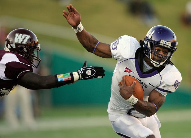 Abilene Christian University running back Bernard Scott (3) slips away from a West Texas A&M defender during a Lone Star Conference game in 2008.