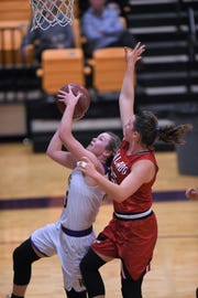 Wylie's Kamryn Dry (30) played in just nine games this season before being lost to an injury in late November. While Dry and Emma Melton will not play again this season, their presence is still felt on the bench.