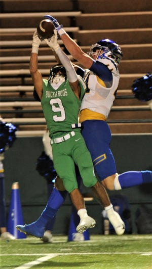 Breckenridge's Angel Ruiz (9) breaks up a pass intended for a Brock receiver during the Region I-3A Division I bi-district playoff game Thursday at Shotwell Stadium.