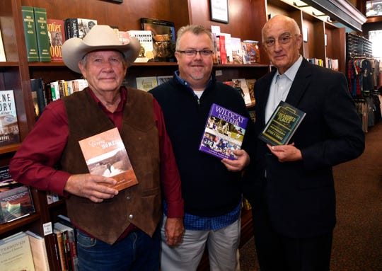 Charles Lynn Russell (left), Lance Fleming and Gary McCaleb are, among other things, local authors. The trio hold their books at Texas Star Trading Company Nov. 13, 2018.