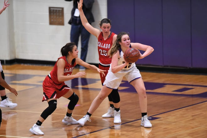 Wylie's Bailey Roberts (42) passes out of a double-team during the first round of the Polk-Key City Classic against Salado at Bulldog Gym. This week she had a solid two games scoring a combined 29 points in two wins for Wylie.