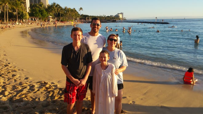 The Cutshalls - parents Ronnie and Chris and kids Andrew and Grace - celebrated Grace's baptism on the shores of Waikiki Beach in 2014.