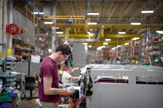 Travys McCauley labels wires in a structure on the assembly floor of Eaton Corporation in Arden on Nov. 1, 2018. The plant builds large electrical components such as motor starters, industrial breakers and huge electrical control panels for customers ranging from hospitals to high-tech data farms.