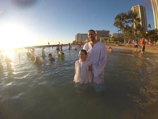 Ben Whitmire, pastor at Locust Grove Baptist Church, baptized Grace Cutshall at Waikiki Beach while the families visited Hawaii during a 2014 high school band trip. Concern over her breathing tube delayed Grace's baptism until after a successful surgery was she 11 years old.