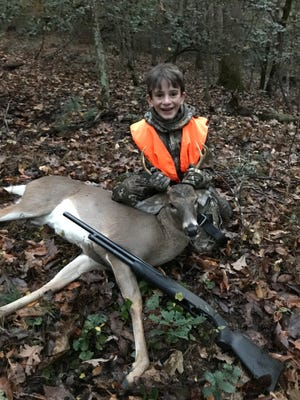 Youth hunting days help develop interest among new hunters. Here, Benjamin Weaver, 12, of Pisgah Forest, shot his first deer on his first attempt while hunting with his father, Patrick Weaver, during a 2017 Youth Deer Hunting Day in Wilkesboro.