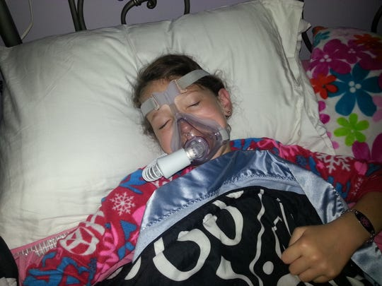 Grace Cutshall wears a mask and heat monitors throughout the night. If she is not attached to life support, she stops breathing when she's asleep.