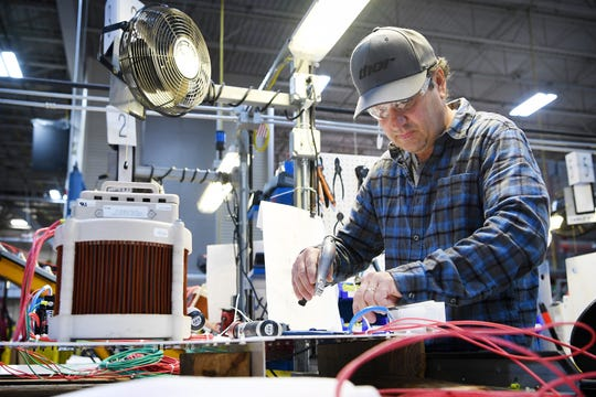 Jeff Ables uses a cable tie gun as he works on a panel on the assembly floor of Eaton Corporation in Arden on Nov. 1, 2018. The 375,000-square-foot plant in Arden employs between 925-950 people now, and in early November they were looking to fill 35-40 jobs.