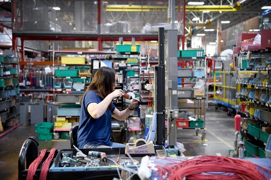 Amelia Wolthers tightens a terminal down on a wires as she works on the assembly floor of Eaton Corporation in Arden on Nov. 1, 2018. The 375,000-square-foot plant in Arden employs between 925-950 people now, and in early November they were looking to fill 35-40 jobs.