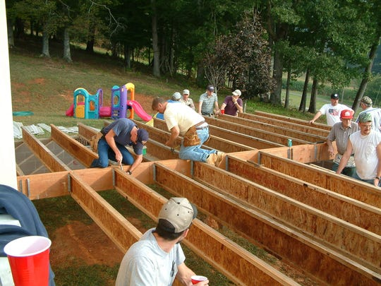 Volunteer crews built an addition outside the Cutshall's Mars Hill home shortly after Grace's birth in 2003.