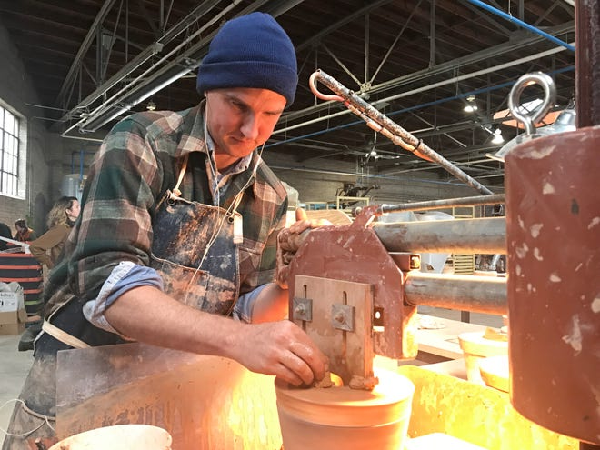 East Fork Pottery employee Pete Shriner working at his station on Wednesday, Nov. 14, 2018. East Fork opened a new production facility this fall at 531 Short McDowell St. in Asheville's Biltmore Village.