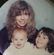 This undated photo shows Kathryn Outman with her daughters, Lauren and Anastasha.