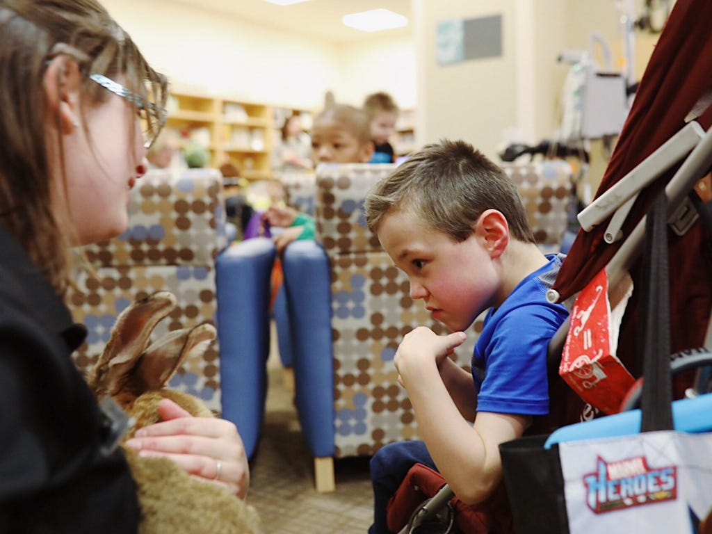 Hannah Smedley, Education Supervisor at Binder Park Zoo, shows off Radar to children at C.S. Mott Children's Hospital in Ann Arbor on Nov, 15, 2018.