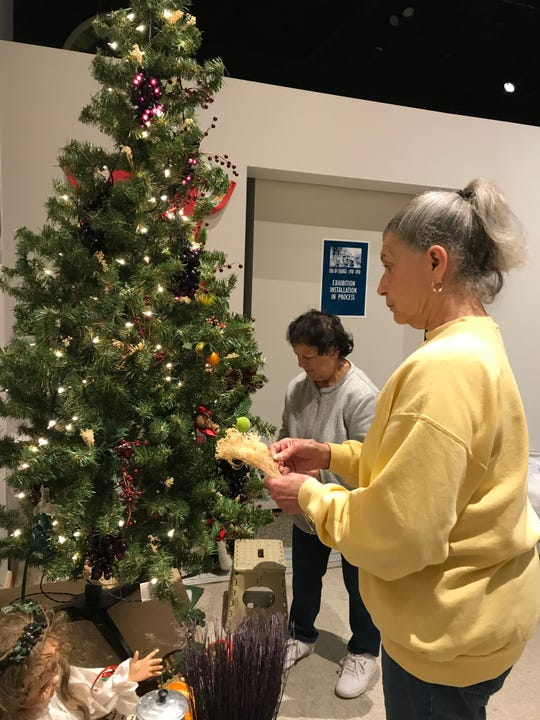 Lucille Polak, left, and Marlene Gioia decorate the Italian tree at Roberson Museum and Science Center's Home for the Holidays event.