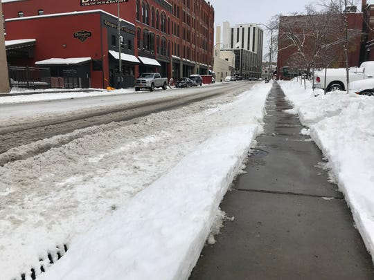 Sidewalks on State Street in Downtown Binghamton were cleared after the first snow of the season Friday morning.