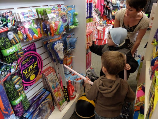 Four-year-old Teddy Smith, foreground, and his brother, Elijah, 5, shop with their mother, Teresa Mogil, of Ithaca, Saturday at Alphabet Soup in 2013.