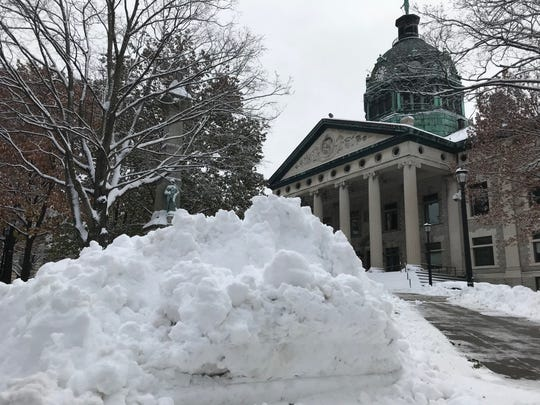 A mound of snow stood outside the Broome County Courthouse in Binghamton after the first big snowfall of the season on Nov. 16.