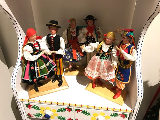 The Polish exhibit at  Roberson Museum and Science Center's Home for the Holidays event includes colorfully decorated dolls, plates, furniture and other items from Poland.