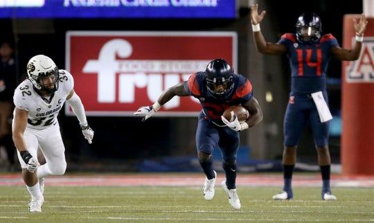 Quarterback Khalil Tate (14) and running back J.J. Taylor lead the Arizona offense.